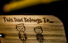 This dad... (Aleem Yousaf) Tags: macromondays nikon d810 nikkor105mm bokeh macro closeup shallow depth field tabletop light studio photography creative flickr madeofwood wooden key chain dad family happy fathers pencil staedtler germany handmade july