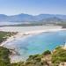Aerial view of the beach of Porto Giunco (Spiaggia di Porto Giunco) and the nearby lake Stagno di Notteri in Sardinia, Italy