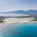 Aerial view of the lake Stagno di Notteri with Marina di Villasimius in the background,  Sardinia, Italy