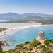 The Tower of Porto Giunco Beach (Spiaggia Torre Porto Giunco) with a view to the beach and the lake Stagno di Notteri in Sardinia, Italy