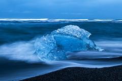 Diamond Beach Jewels (explored 30/07/19) (Dom Haughton) Tags: iceland jokulsarlon diamondbeach seascape ice iceberg water movingwater rushingwater swirlingwater sand blacksand atlantic ocean sea seashore outdoor
