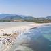 Aerial view of the sand beach of Porto Giunco near the lake Stagno di Notteri in Sardinia, Italy