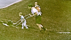 Mow Together (fillzees) Tags: tele grass green child man yard lawn mower lawnmower candid street backpack fx shorts boy son father extraordinary grainy