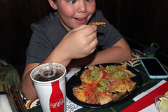 Nachos 1882 (casch52) Tags: food boy eat lifestyle home snack man nachos drink background people meal male bread chips entertainment dinner leisure chip party break restaurant happy caucasian young teenager joy delight kids tasty mexican kid smile eating salsa tomato avocado cornchip smiling crosseyed cheese