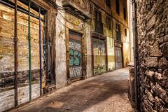A Barred Backstreet (henriksundholm.com) Tags: street road night city urban gothicquarter abandoned closed barred backstreet path graffiti walls buildings empty bend corner curve hdr barcelona spain espana catalonia
