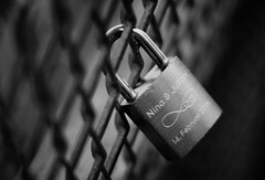 Locked in Love (henriksundholm.com) Tags: lovelock lock padlock fence dof depthoffield shadows hearts love monteliusvägen södermalm metal steel 50mm bw blackandwhite monochrome stockholm sverige sweden