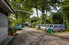 Vans of Pulau Ubin (henriksundholm.com) Tags: landscape pulauubin vans cars parking street road village daylight nature tropic trees trashcan cone hdr island singapore southeast asia