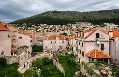 Houses on the Slope (henriksundholm.com) Tags: landscape daylight houses buildings city urban oldtown grass ruins mountain hill terrace walls citywall hdr dubrovnik croatia