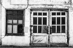 Cracked facade (trochford) Tags: garage building old sagging crumbling deteriorating cracked facade abandoned window doors masonry cinderblock concreteblock garfield garfieldwa garfieldwashington wa washington inlandnorthwest us usa unitedstates bw bnw blackandwhite blackwhite noiretblanc blancoynegro mono monochrome canon canon6d ef24105mmf4lisusm ef24105