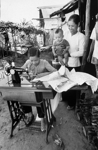 Vietnamese Nguyen Thi Tron, a young amputee who lost her leg during an accidental US helicopter attack near her village, sewing her clothes. by manhhai Attribution, From FlickrPhotos