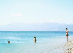 Life Is A Beach : Domino (Storyteller.....) Tags: beach life sea summer greece man women domino dive blue sky swimsuit