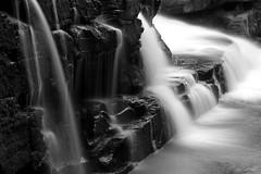 Shadowy Fall (SunnyDazzled) Tags: waterfall falls water stream shohola pennsylvania nature longexposure evening cliff rocks geology bw