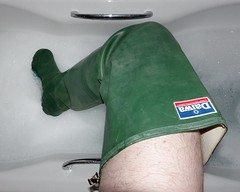 Bathtime in Waders (essex_mud_explorer) Tags: waders thigh boots rubber rubberboots rubberwaders thighwaders thighboots daiwa coarsefisher green madeinscotland madeinbritain vintage bath bathing wet underwater foam bubblebath fun hunterboots hunterwaders gates uniroyal