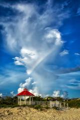 Rainbow Hearts Power Station (Juan Paz V) Tags: rainbow sand beach clouds blue yellow green red gazebo white bars fence hotel keys cayos santa maria cuba