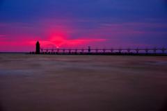 South Haven, MI (dangaken) Tags: southhaven lighthouse beach shore lake greatlakes lakemichigan mi michigan mich sunset dusk westside freshcoast puremichigan bluehour shoreline water waterfront red fuji fujifilm fujixmount fujixsystem fujifilmxsystem fujix fujifilmx sun pier breakwater harbor