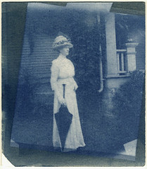 Woman with Black Umbrella (Robert Drozda) Tags: locationunknown woman glassnegative cyanotype pop contactprint sunprint house dress hat umbrella historicphoto altprocess drozda
