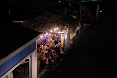 The Idler - Black River, South Haven, MI (dangaken) Tags: southhaven lighthouse beach shore lake greatlakes lakemichigan mi michigan mich sunset dusk westside freshcoast puremichigan bluehour shoreline water waterfront red theidler idler bar nightclub beer drink drinks tiki tikibar night nightlife fuji fujifilm fujixmount fujixsystem fujifilmxsystem fujix fujifilmx