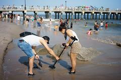 Beachcombers (dtanist) Tags: nyc newyork newyorkcity new york city sony a7 7artisans 35mm brooklyn coney island beach sand sea shore steeplechase pier boardwalk beachcomber beachcombing combing metal detector