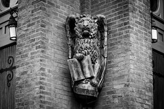 St. Mark's Grotesque (John Brighenti) Tags: capitolhill washington dc districtofcolumbia blackandwhite bw monochrome greyscale contrast light shadow white black dark architecture moody lonely lines stone brick masonry marble carved building sony a7 ilce7 streetphotography photography flickr bealpha sonyshooter church grotesque doors lion statue lights
