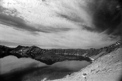 Crater lake from Merriam Point (bac1967) Tags: kodak kodakfilm kodakhie kodakhieinfraredfilm infrared 35mmfilm 35mm 135film minoltasrtscii minolta minoltaslr slr slrcamera blackandwhite blackandwhitefilm monochrome monotone mountains craterlake expiredfilm expired oregon cascades cascade volcano crater clouds wizardisland pnw pacificnorthwest rodinal150 rodinal craterlakenationalpark nationalpark lake deeplake tamronadaptall2 tamron adaptall 2 24mm