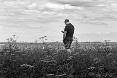 The Message (Alfred Grupstra) Tags: men outdoors people nature oneperson adult males field caucasianethnicity lifestyles ruralscene standing grass summer walking blackandwhite sky meadow onemanonly day 84 cellphone phone