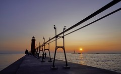 Back to Grand Haven (EricMakPhotography) Tags: lighthouse breakwater michigan sunset glow sun flare lake water red twilight