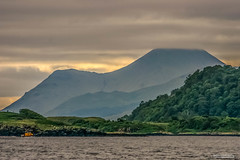 "Telephoto image of Calve Island near Tobermory Bay looking south-east to Beinn Talaidh. (Scotland by NJC.) Tags: mountains hills highlands peaks fells massif pinnacle ben munro heights جَبَلٌ montanha 山 planina hora bjerg berg montaña vuori montagne βουνό montagna fjell coastline 海岸线 litoral côte küste linea costiera 海岸線 해안선 seashore coast shore seaboard seaside beach strand forest woodland plantation trees grove ""temperate rainforest"" غَابَة floresta 森林 šuma les skov bos ""bosque grande"" metsä forêt wald δάσοσ foresta skog las pădure tobermory soundofmull beinntalaidh isleofmull"