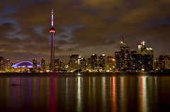 Toronto at Night from Toronto Islands, Ontario, Canada (klauslang99) Tags: architectural architecture attractions building buildings canada canadian cities city citylights cityscape cityscapes cntower destinations dusk evening graphic graphics highrises horizontal illuminated illumination images klauslang lakeontario lakes landmark metro metropolitan moderncity municipality nighttime ontario outdoor outdoors outside picture pictures reflection reflections rogerscentre skyscraper skyscrapers stockimage stockphotograph stockphotographs stockphotos structure structures tallest toronto torontoskyline tourism touristattraction touristattractions tower travel traveldestination traveldestinations urban water waterfrontproperty