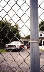 Macungie, PA. Summer 2017. Olympus XA2. (preston161) Tags: elcamino classiccar fence chainlink 35mm olympus xa2