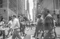 Riding a bike in the middle of people walking in Manhattan. Rush hour. (Capitancapitan) Tags: bike riding walking people rush hour manhattan black white photography street pentax k500 k50 instagram facebook youtube neury luciano el mundo gira urim y tumim rock pop music