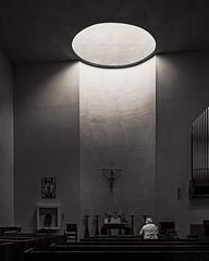 Praying In The Heavenly Light (Mike Schaffner) Tags: altar bw blackwhite blackandwhite candles canontse24mmf35lii chapel chapelofstbasil church crucifix monochrome prayer praying tiltshift university universityofstthomas