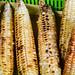 Grilled corn on green container