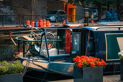 Lifestyle (Мaistora) Tags: boat narrowboat ship vessel river canal riverboat street lifestyle bike bicycle flowers cars urban city romantic eccentric hippy film analogue style living alternative outdoor open air water nature elements adventure grandunion paddington paddingtoncentral basin london england britain uk thames thamesvalley leica dlux typ109 lightroom skylum luminar flex color colour colourful grading lut