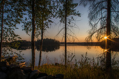 July sunset (mabuli90) Tags: finland lake water sky clouds tree sun forest sunset north karelia longexposure nature landscape rock dock boat