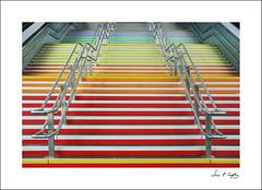 Step Up to the Rainbow (Simon Caplan) Tags: colourful colour multicoloured rainbow steps stairs railwaystation railway reading berkshire readingengland readinguk architecture architecturaldetail