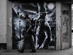 Time Traveller (Silver Machine) Tags: london whitechapel streetphotography street candid graffiti streetart man walking fujifilm fujifilmxt3 fujifilmx fujinonxf35mmf2rwr