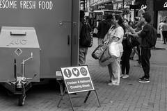 Chicken and Halloumi Crossing.  Reading. #reading #berkshire #readingtowncentre #readingfestival #blackandwhite #chicken #halloumi #streetphotography #hotdogstand (tsummers471) Tags: reading berkshire readingtowncentre readingfestival blackandwhite chicken halloumi streetphotography hotdogstand