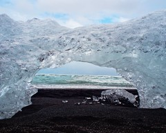 Glacier Ice (Caleb Bertolini) Tags: iceland ice water olympus glacier clear white blue ocean wave diamond beach crystal nature natural scenery shadows shadow sky clouds cloud black sand