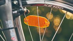 Reflective Guardian (Kot Orator) Tags: bicycle bike tire reflection reflector bokeh orange sun sunlight fork summer helios helios44m poland poznan sony alfa a7ii