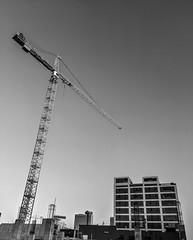 Construction Crane (explored) (jolynne_martinez) Tags: construction crane building architecture crossroads crossroadsartsdistrict kansascity monochrome bw blackandwhite googlepixel architectureinpixels explore flickraward explored