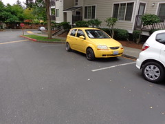 DSC00512 (Bellevue Bob) Tags: 2004 chevrolet aveo yellow