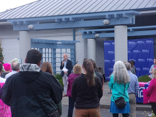 Representative Rick Larsen standing with Planned Parenthood in Bellingham during a rally in July 2 2019