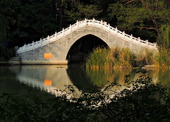 Moon bridge water-reflected in Chinese garden (German Vogel) Tags: relaxing baohe serene waterreflection pond river park publilcpark garden landscaping asia travel tourism traveldestinations touristattractions famousplace eastasia china hefei anhuiprovince locallandmark bridge moonbridge pedestrianbridge chinesegarden anhui
