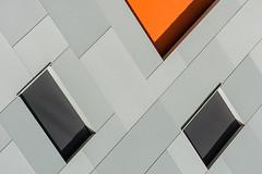 A hint of orange (jefvandenhoute) Tags: belgium belgië brussels brussel molenbeek light shapes geometric orange wall windows