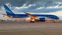Azerbaijan Airlines 787. (spencer_wilmot) Tags: lhr lhregll egll london longhaul landinggear heathrow heavy sideon evening eveninglight sunset dusk clouds aviation aircraft airplane airliner airport arrival airside apron boeing dreamliner boeingdreamliner boeing787dreamliner 787 7878 788 b788 b787 vpbbr azal ahy j2 j2ahy azerbaijanairlines civilaviation commercialaviation ramp taxiway twin plane passengerjet jet jetliner widebody rakedwingtips