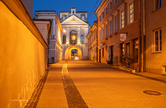 The Gate of Dawn (pietkagab) Tags: gateofdawn gate vilnius ostrabrama oldtown town city buildings architecture street walls holy pilgrimage place lithuania lithuanian night bluehour sky europe european evening pietkagab photography piotrgaborek travel trip tourism sightseeing sonya7