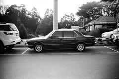 1984 BMW 528i (E28).... (Matthew Paul Argall) Tags: zenit35f 35mmfilm ilforddelta100 100isofilm blackandwhite blackandwhitefilm car vehicle automobile transportation classiccar bmw bmw528i carspotting