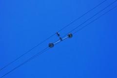 Avoiding Short Circuits (Viejito) Tags: pge pacificgasandelectric highvoltage powerlines sanluisobispo california slo montereystreet torostreet usa unitedstates geotagged geo:lat=35283567 geo:lon=120658523 amerika amérique américa canon powershot s100 canons100 blue sky transmissionline insulate isolate diagonal