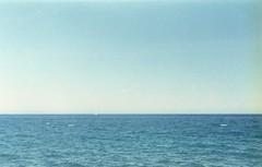 Le p'tit bateau (•Nicolas•) Tags: 200iso camera canaryislands collection color colorplus espagne holidays kodak lanzarote leicaiiif nicolasthomas spain vacances vintage horizon boat sea minimal simple blue