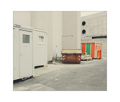 Private Assemblage (Thomas Listl) Tags: thomaslistl color 35mm containers toilet grey facade mundane topography concrete wall orange green banal